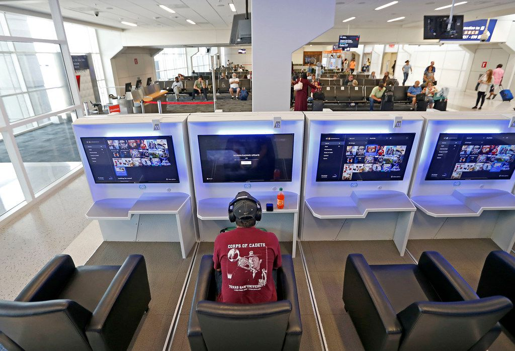 Traveler Chris Debruhl plays an online game while waiting for his flight at Gaemway next to the gate 16 inside Terminal E of Dallas/Fort Worth International Airport in DFW Airport, Texas, Friday, July 6, 2018.