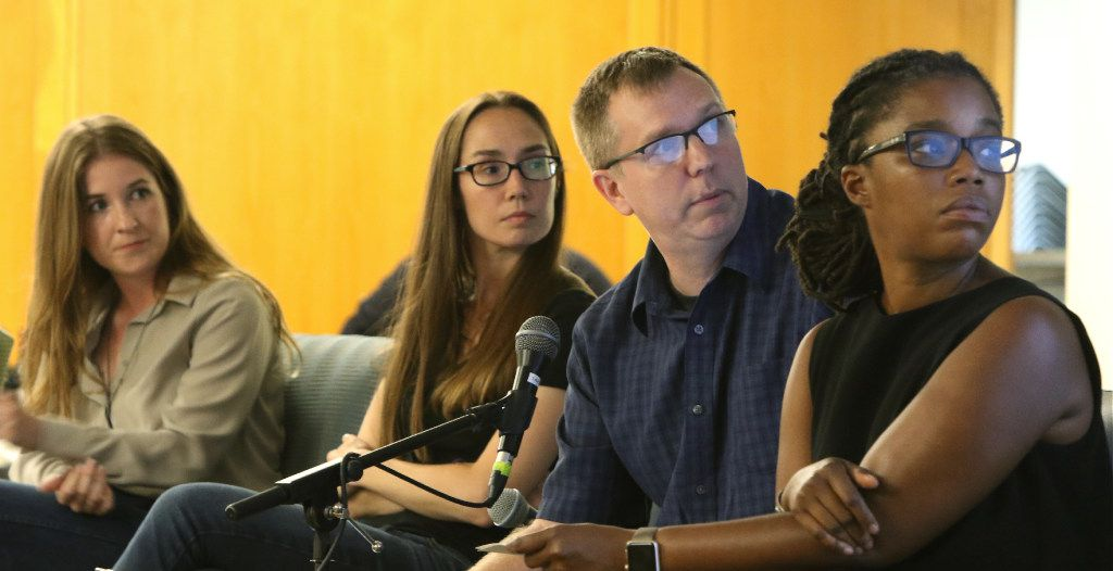 Smiley Pool, center, talks about the day of the ambush as Rose Baca, left, Ashley Landis, and The Dallas Morning News director of photography Marcia Allert, right, listen during a discussion about the July 7th ambush at J. Erik Jonsson Central Library, on Thursday evening, July 6, 2017, in Dallas Texas.