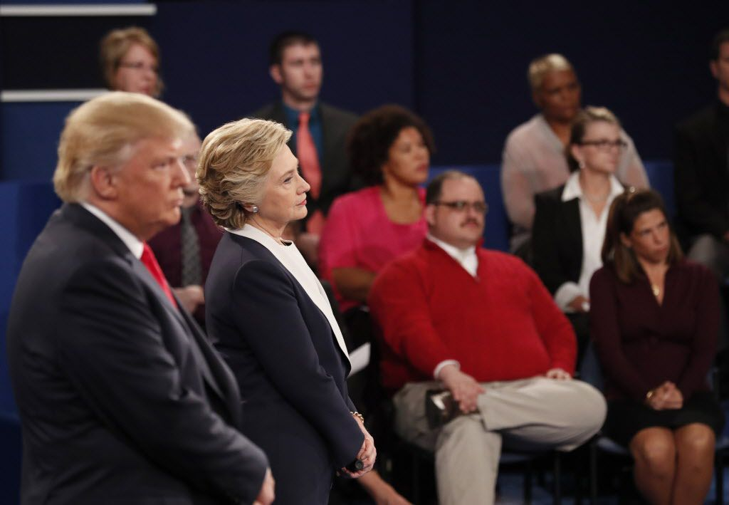 Republican presidential nominee Donald Trump and Democratic presidential nominee Hillary Clinton listened to a question during the second presidential debate at Washington University in St. Louis on Oct. 9.