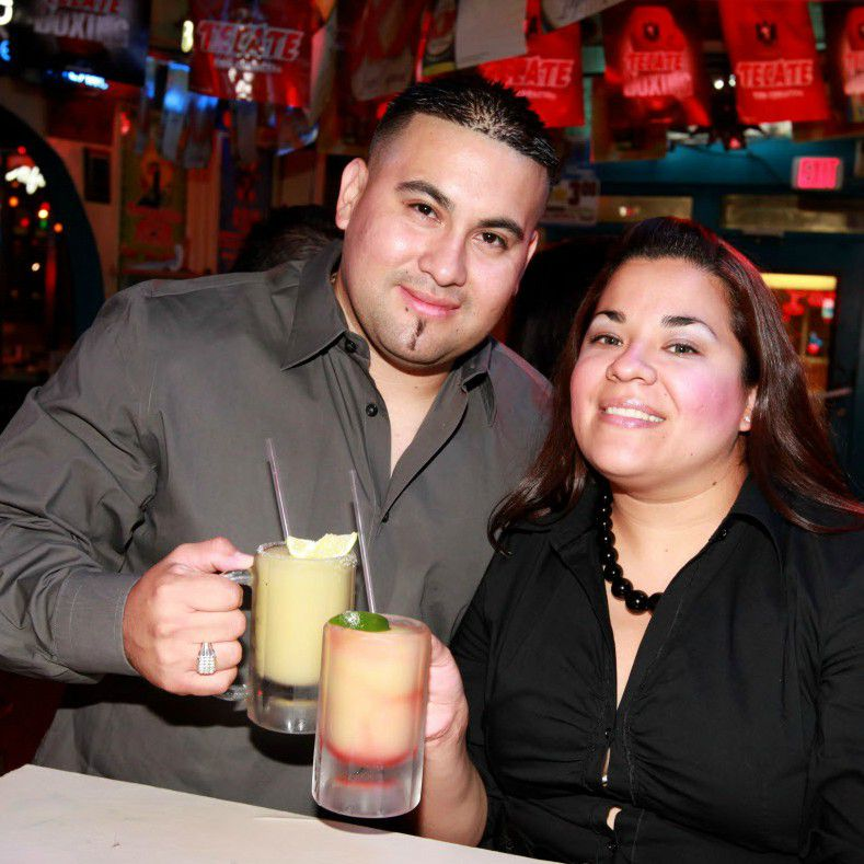 A couple holds frozen drinks at the  Blue Goose Cantina in Dallas.