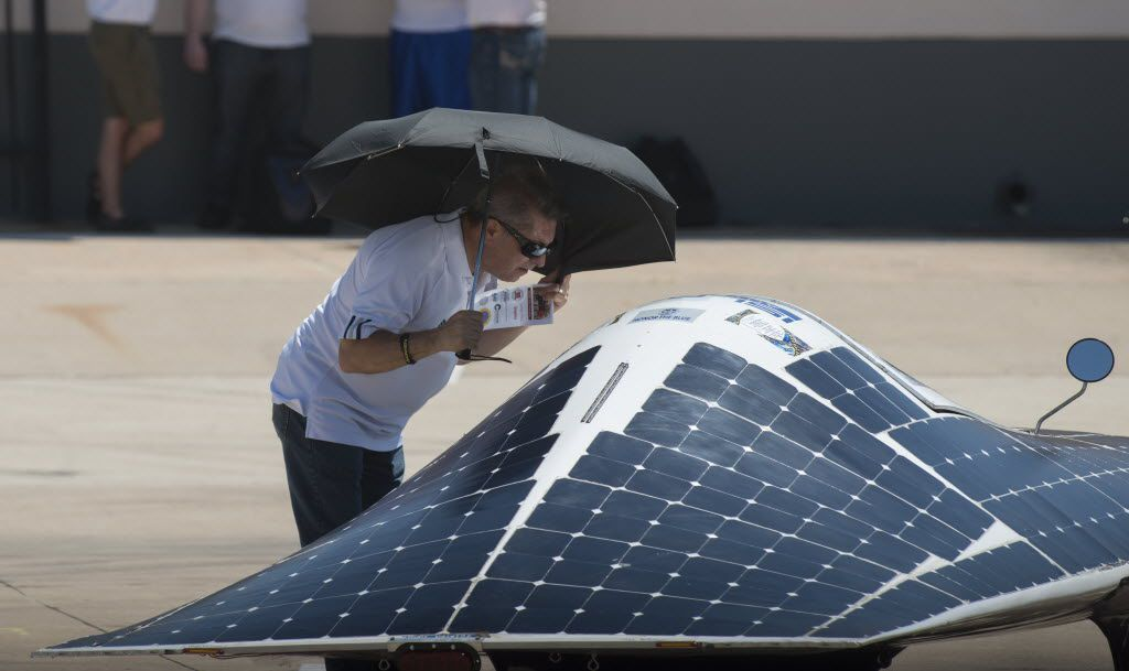 Edwin Montoya gets a close look at one of the solar cars participating in the Solar Challenge, a program designed to help high school students   learn more about science, engineering, and alternative energy taking place at Texas Motor Speedway in Fort Worth, Texas on July 13, 2016. (Robert W. Hart/Special Contributor)
