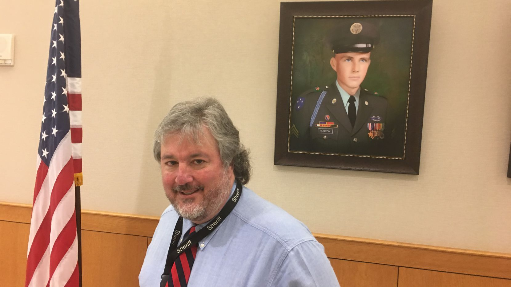 Artist Colin Kimball stands before a portrait he painted of Joe Huston, 20, killed in action in Vietnam in 1969. Huston was from Plano. He was posthumously awarded a Silver Star.