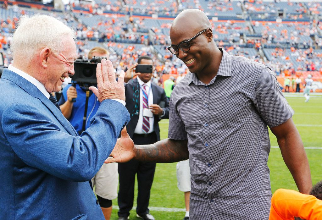 Dallas Cowboys owner and general manager Jerry Jones shares a laugh with former Dallas Cowboys player DeMarcus Ware before a game between the Dallas Cowboys and Denver Broncos at Sports Authority Field in Denver on Sunday, September 17, 2017. (Vernon Bryant/The Dallas Morning News)