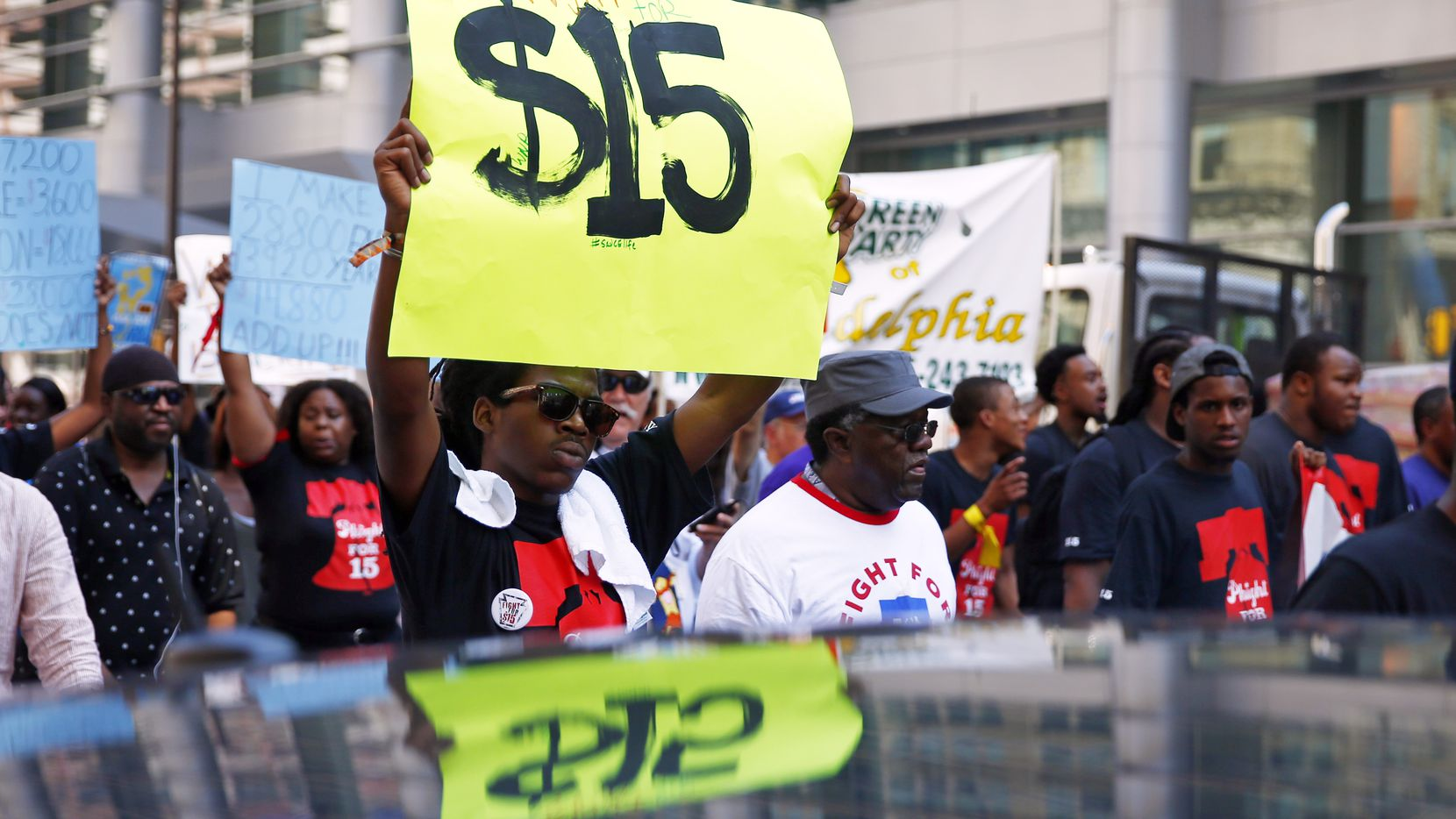 """The """"Fight for $15"""" movement, captured in this 2014 file photo from Philadelphia, has helped to increase the minimum wage in many states and cities — but not Texas. More workers in Texas would benefit from a $15 wage floor than in any state, according to one study."""