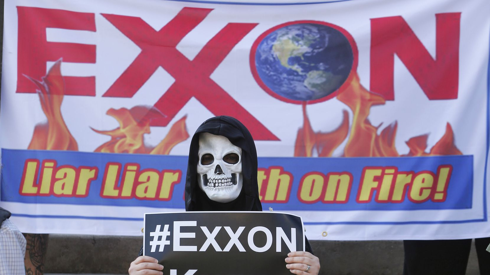 Shannon Carter wears a skeleton mask while dressed as an oil rig as protesters gather outside of the Exxon shareholders meeting across the street from Morton H. Meyerson Symphony Center in Dallas on May 31, 2017.  (Nathan Hunsinger/The Dallas Morning News)