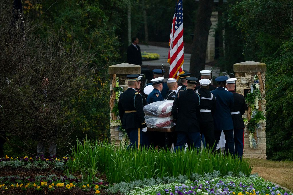 The flag-draped casket of President George H.W. Bush is carried to the burial plot close to his presidential library for internment on Thursday, Dec. 6, 2018, in College Station, Texas. (Smiley N. Pool/The Dallas Morning News)