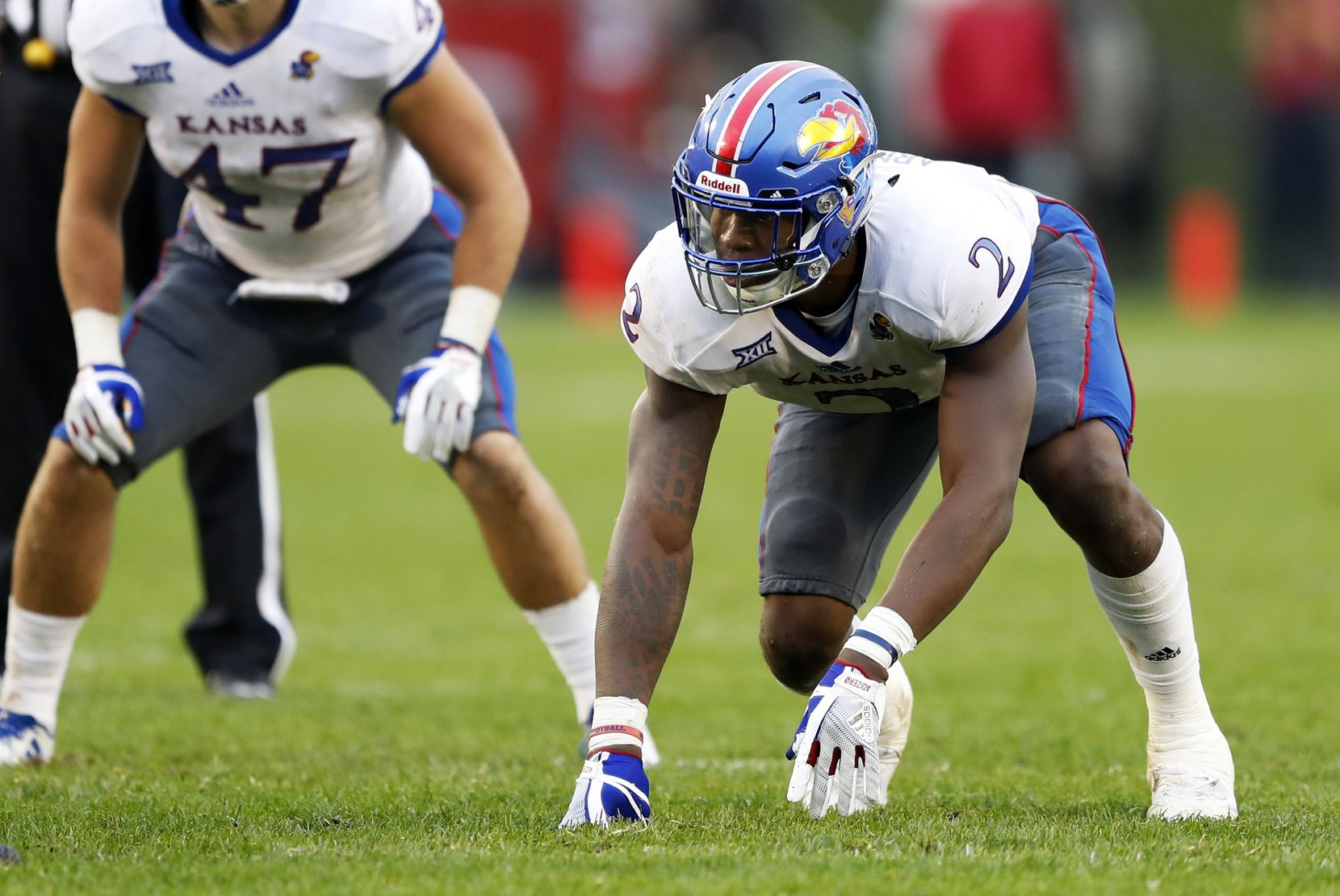 FILE - Kansas defensive end Dorance Armstrong Jr. (2) gets set for a play during the second half of an NCAA college football game against Iowa State, Saturday, Oct. 14, 2017, in Ames, Iowa. (AP Photo/Charlie Neibergall)