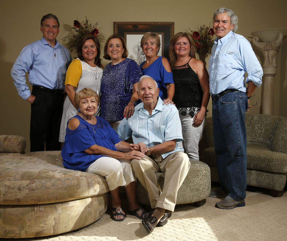 Frank and Carole Barbosa (sitting) pose for a photograph with their sons and daughters as they celebrate their 65th wedding anniversary at their daughter Ani Stone's home in Dallas, Wednesday, July 26, 2017. From left in a back row, Ronnie Barbosa, Kathy Holcombe, Ani Stone, Brenda O'Shel, Angela Howery and Drew Barbosa.