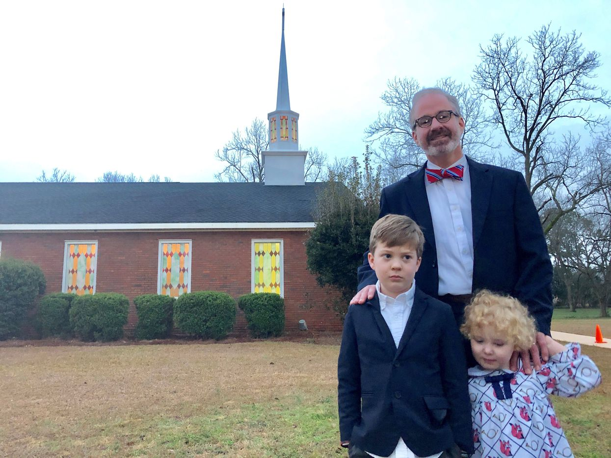 """Stephen Wilson, with his children Drew and Sarah, admires Carter for his """"moral authority."""""""