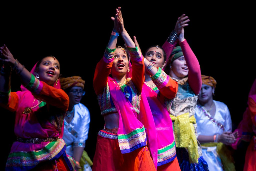 Performers on stage performing during Diwali Mela at Fair Park  in Dallas.