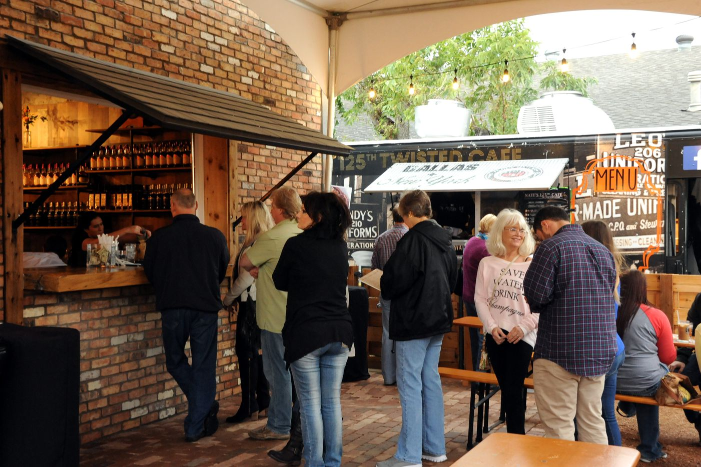 Guests wait in line at the outside bar for specialty cocktails at Witherspoon Distillery in Lewisville, TX on October 24, 2015.