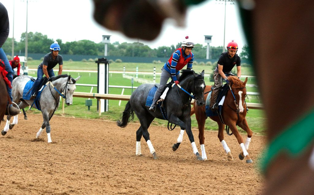 Horse exercisers and jockeys worked out their horses on April 17 at Lone Star Park in Grand Prairie. The track will celebrate its 20th anniversary on April 20.