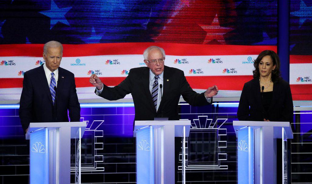 Democratic presidential candidate Sen. Bernie Sanders spoke as former Vice President Joe Biden and Sen. Kamala Harris looked on during the second night of the first Democratic presidential debate on June 27 in Miami.