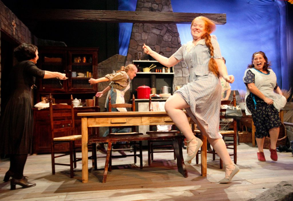 Jacie Hood Wenzel (Christine Mundy) and Lorna Woodford (Agnew Mundy), far-right, dance around a table with other actors during a dress rehearsal for Dancing at Lughnasa, on Wednesday, Sept. 07, 2016 at the Contemporary Theatre of Dallas in Dallas.