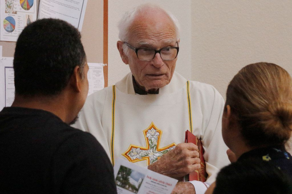 The Rev. Tim Gollob visits with parishioners after Mass at Holy Cross Catholic Church. He says many of his parishioners share anxiety about their futures.