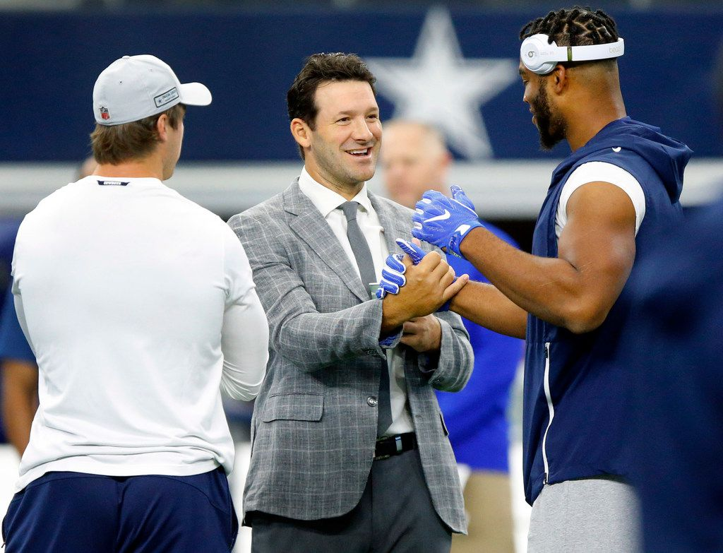 Former Dallas Cowboys quarterback and CBS sportscaster Tony Romo (center) is greeted by former teammates Rico Gathers (right) and Sean Lee during warmups at AT&T Stadium in Arlington, Texas, Sunday, October 14, 2018. The Dallas Cowboys are facing the Jacksonville Jaguars. (Tom Fox/The Dallas Morning News)