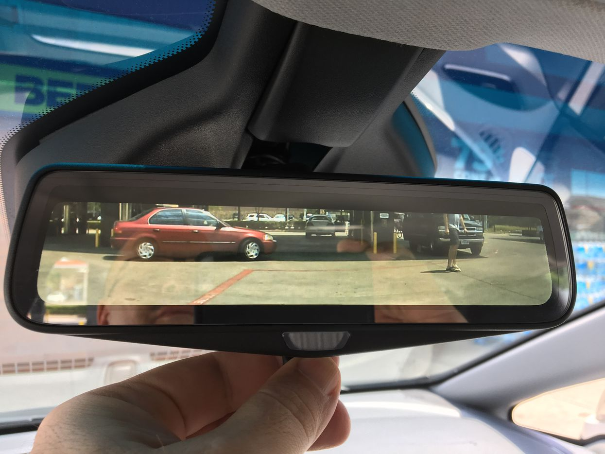 The rear view mirror has a small LCD screen that shows the backup camera when you flip the switch on the mirror.