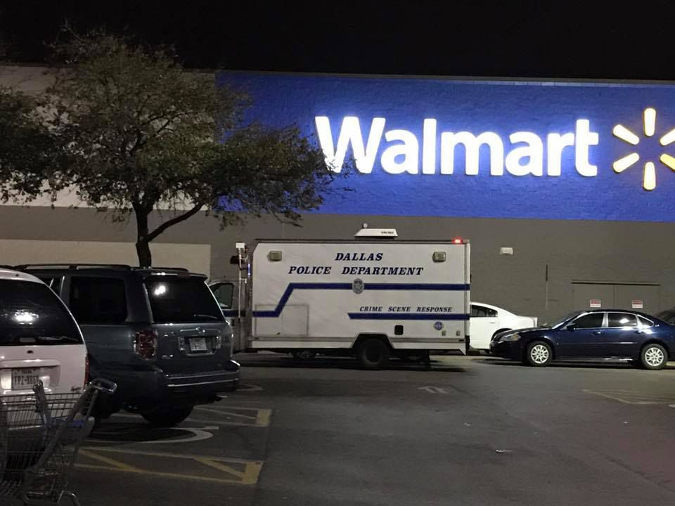 Dallas police investigate an shooting outside a Wal-Mart on Sunday night in the 7400 block of Samuell Boulevard in Dallas.