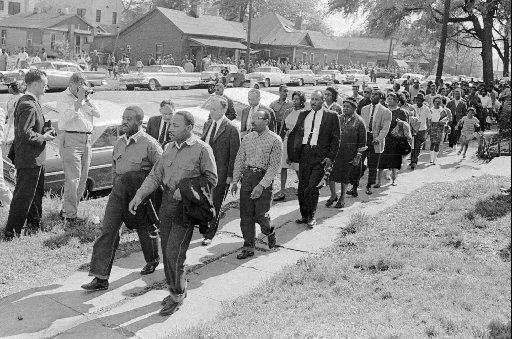 Martin Luther King Jr., front right, and Ralph  Abernathy lead a line of demonstrators who attempted to march on  city hall in Birmingham, Ala., in April, 1963.