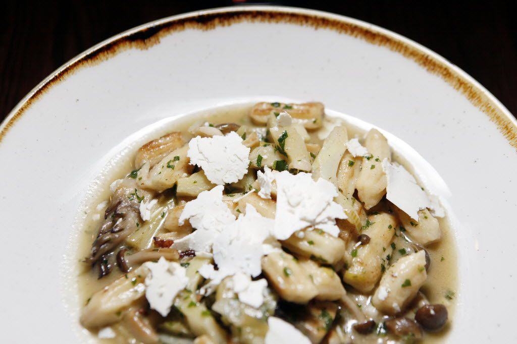 Parsley root gnocchi with roasted mushrooms, braised artichokes and ricotta salata