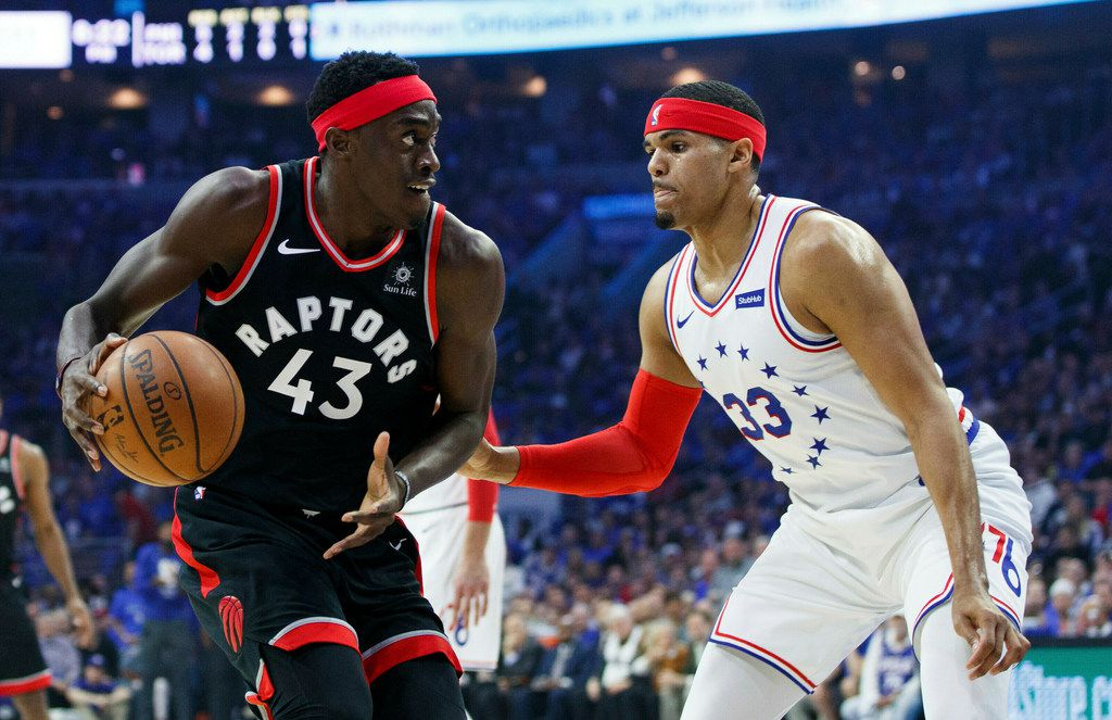 Toronto Raptors' Pascal Siakam, left, looks to make a move against Philadelphia 76ers' Tobias Harris during the first half of Game 3 of a second-round NBA basketball playoff series Thursday, May 2, 2019, in Philadelphia. (AP Photo/Chris Szagola)