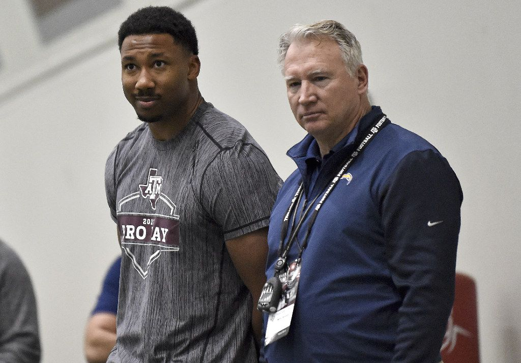 Former Texas A&M defensive end Myles Garrett, left, looks on during Texas A&M Pro Day at the NCAA football team's indoor training facility, Thursday, Match 30, 2017, in College Station, Texas. The event is to showcase players for the upcoming NFL football draft. (AP Photo/Eric Christian Smith)