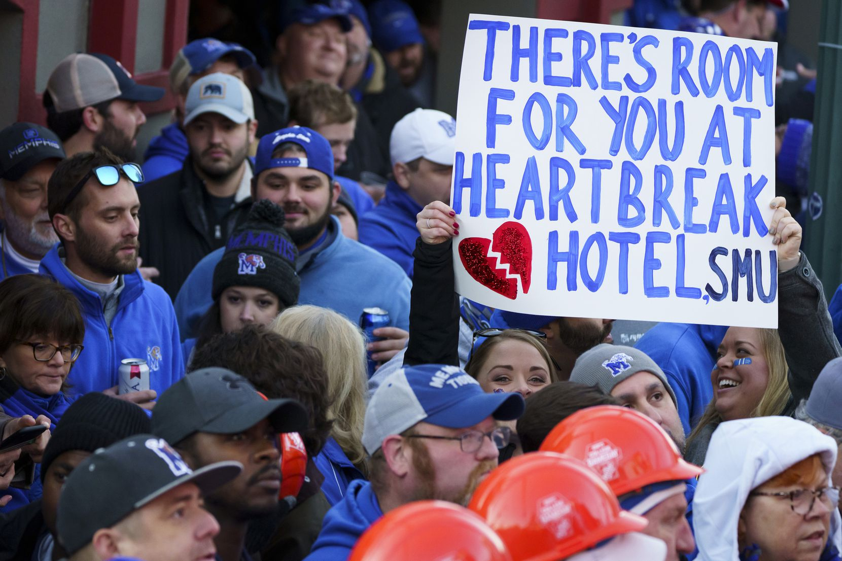 A sign references the Elvis son ÒHeartbreak HotelÓ during  ESPN College GameDay before an NCAA football game between Memphis and SMU on Saturday, Nov. 2, 2019, in Memphis, Tenn.