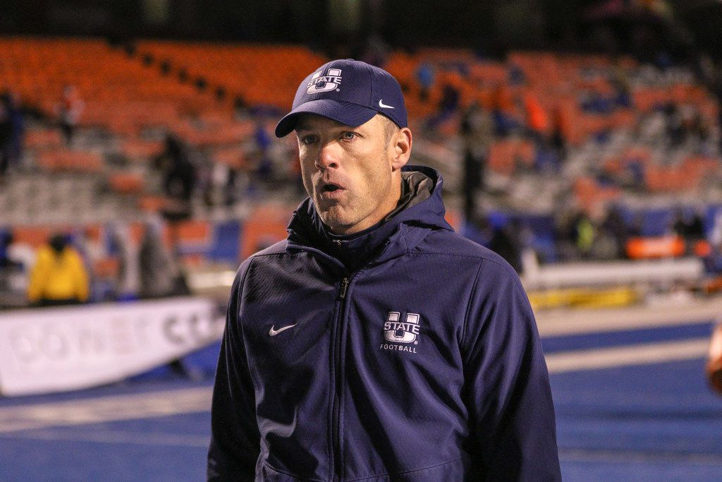BOISE, ID - NOVEMBER 24: Head Coach Matt Wells of the Utah State Aggies walks off the field at the conclusion of second half action against the Boise State Broncos on November 24, 2018 at Albertsons Stadium in Boise, Idaho. Boise State won the game 33-24. (Photo by Loren Orr/Getty Images