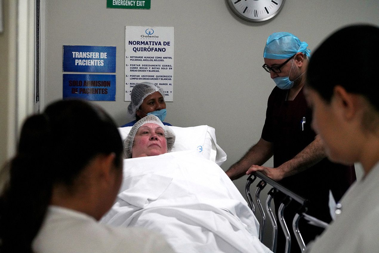 Donna Ferguson is wheeled into surgery at Galenia Hospital in Cancun. (Rocco Saint-Mleux for Kaiser Health News)