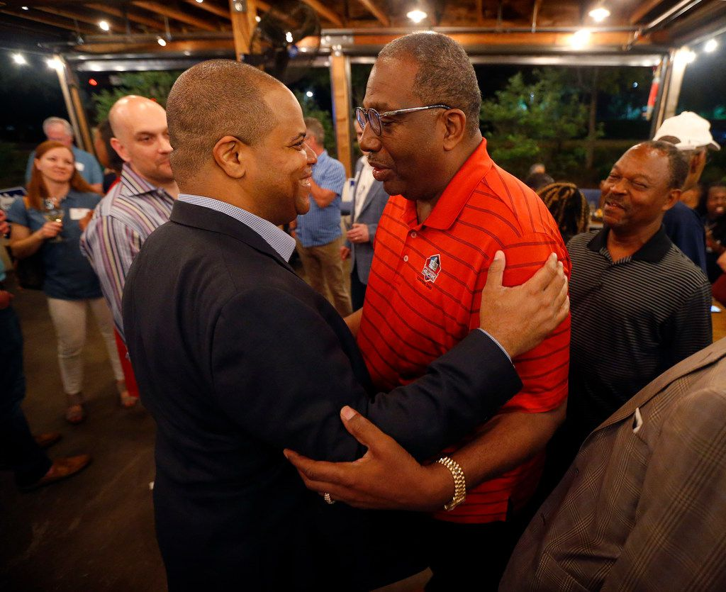 Dallas mayoral candidate and state Rep. Eric Johnson (left) is congratulated by state Sen. Royce West of Dallas during an election night party at Smoky Rose restaurant on May 4, 2019.