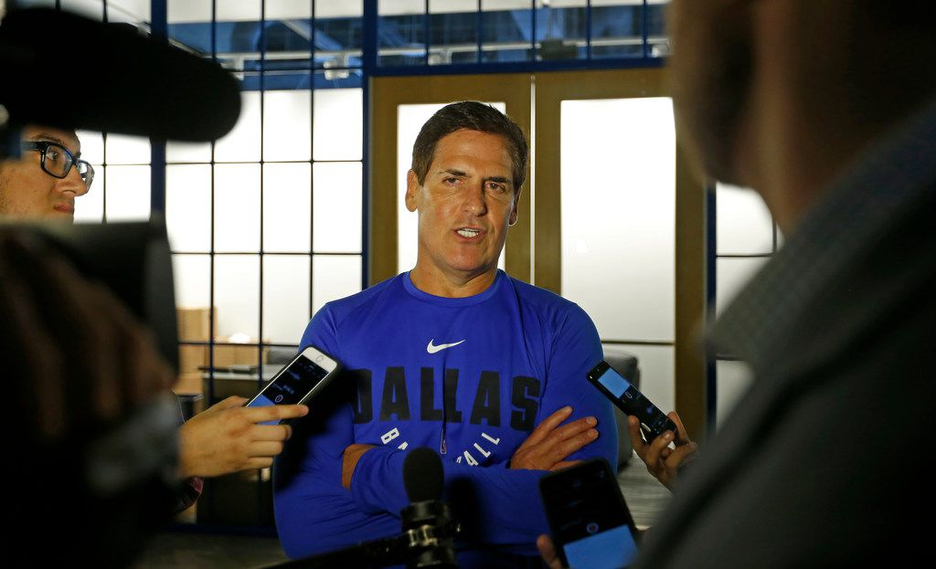 Dallas Mavericks owner Mark Cuban (center) talks with the  media in an interview during the media day at American Airlines Center in Dallas, Monday, Sept. 25, 2017. (Jae S. Lee/The Dallas Morning News)