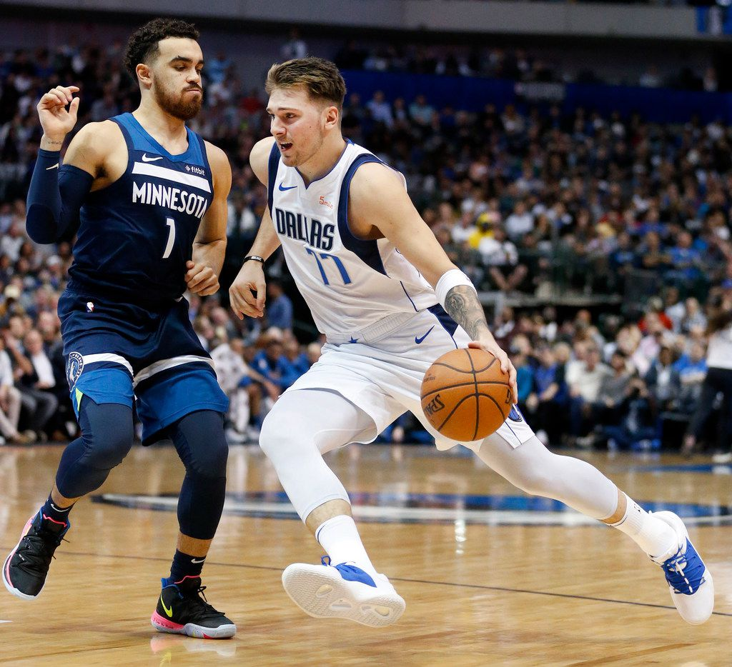Dallas Mavericks forward Luka Doncic (77) drives past Minnesota Timberwolves guard Tyus Jones (1) during the first half at the American Airlines Center in Dallas, Wednesday, April 3, 2019. (Tom Fox/The Dallas Morning News)