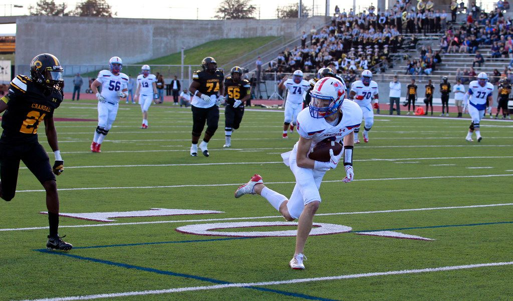 Midlothian Heritage's Jay Wilkerson (8) is wide open and takes his pass reception to the end zone for a touchdown during the Class 4A  Division I area-round playoff high school football playoff game against Crandall at Kincaide Stadium in Dallas, Friday, November 24, 2017. (John F. Rhodes / Special Contributor)
