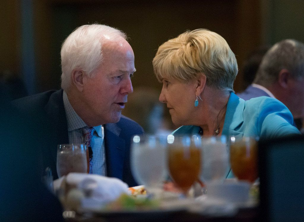 Sen. John Cornyn speaks with Fort Worth Mayor Betsy Price at the Omni Hotel in Fort Worth.