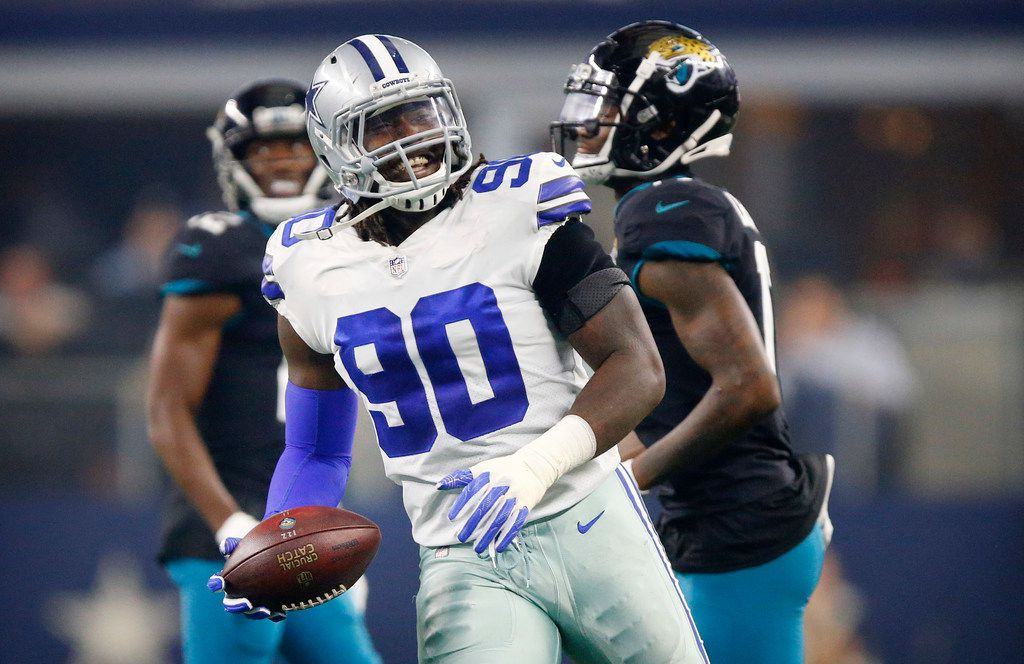 Dallas Cowboys defensive end Demarcus Lawrence (90) flashes a big smile after he helped break up a Jacksonville Jaguars pass attempt during the first half at AT&T Stadium in Arlington, Texas, Sunday, October 14, 2018. (Tom Fox/The Dallas Morning News)