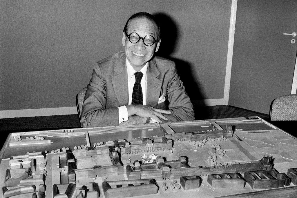 Chinese-American architect Ieoh Ming Pei poses with the architectural model of the Louvre Pyramid in Paris.