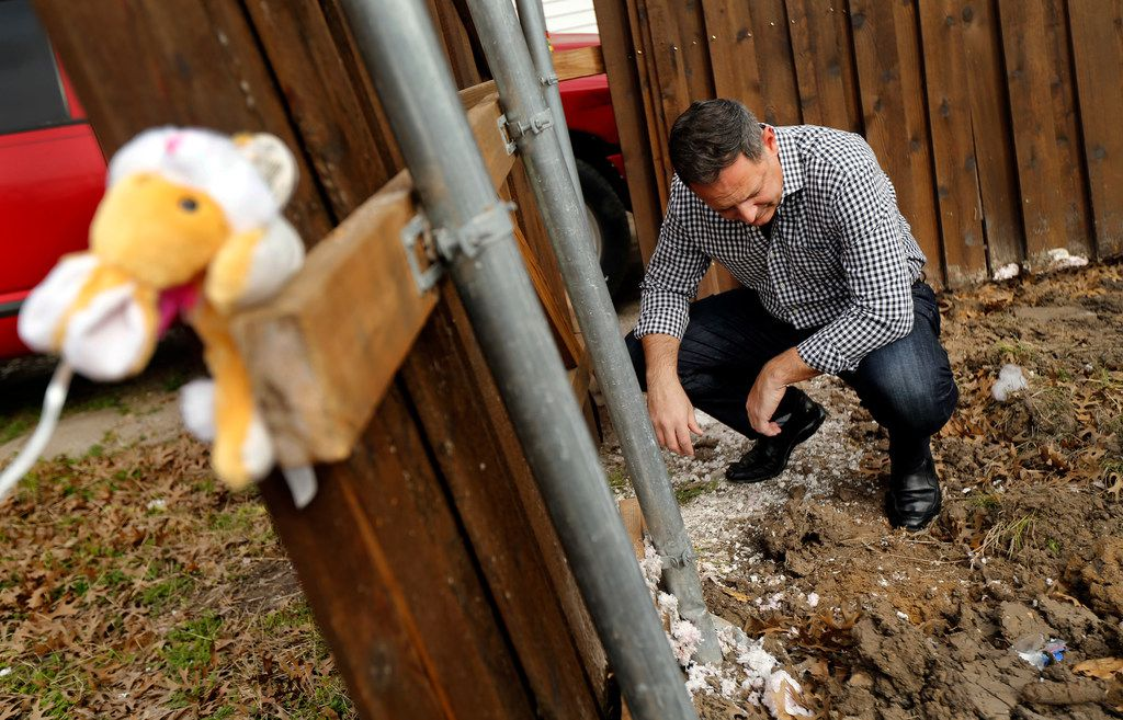 """Rep. Rafael Anchia inspects debris left behind after a demolition crew razed the remnants of the home on Espanola Drive in Dallas where 12-year-old Linda """"Michellita"""" Rogers died in a natural gas explosion last year."""