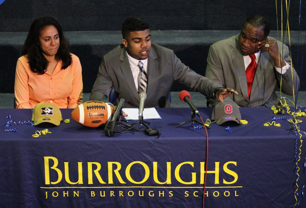 Flanked by his parents, Dawn and Stacy Elliott, John Burroughs running back Ezekiel Elliott announces his committment to Ohio State University on Wednesday, Feb. 6, 2013, at John Burroughs School in St. Louis. (Chris Lee/St. Louis Post-Dispatch)