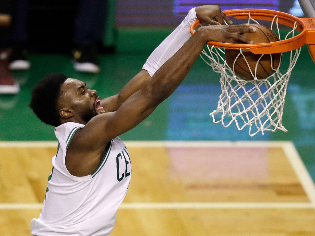 Boston Celtics guard Jaylen Brown dunks against the Cleveland Cavaliers during the second half in Game 7 of the NBA basketball Eastern Conference finals, Sunday, May 27, 2018, in Boston. (AP Photo/Charles Krupa)