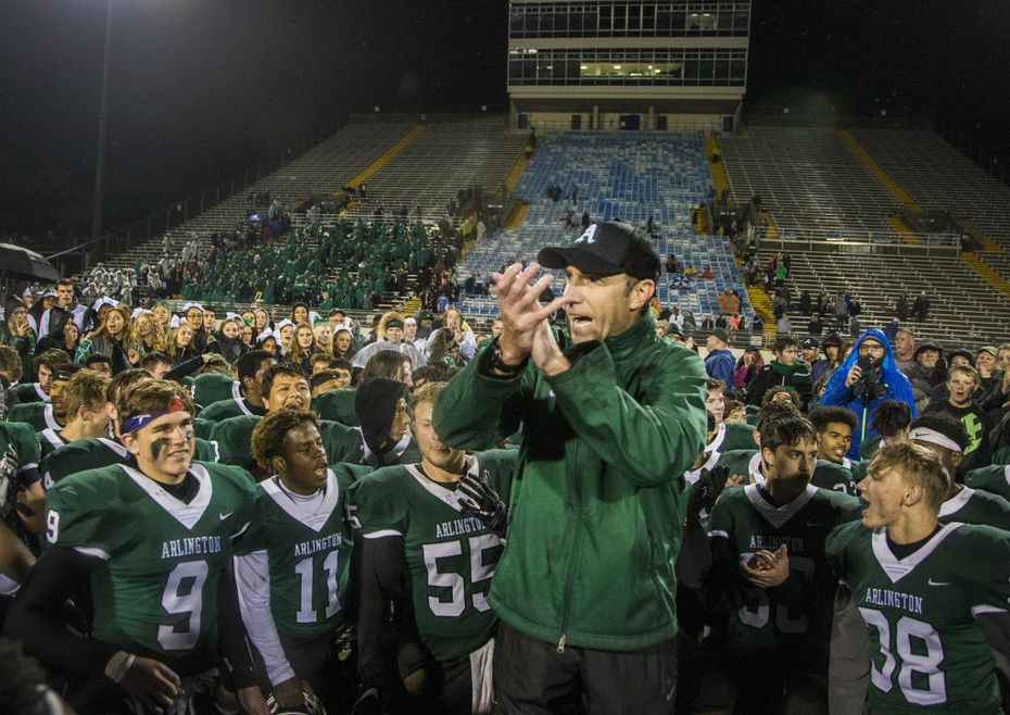 Head coach Scott Peach thanks the coaching staff after winning the high school football game between Arlington and Lamar High School at Maverick Stadium in Arlington on Nov. 8, 2018. (Carly Geraci/The Dallas Morning News)