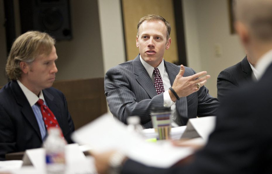 Sitton speaks with scientists about their study of earthquakes in North Texas. He was accompanied by his spokesman and chief of staff, Jared Craighead (left). (Thao Nguyen/Special Contributor)