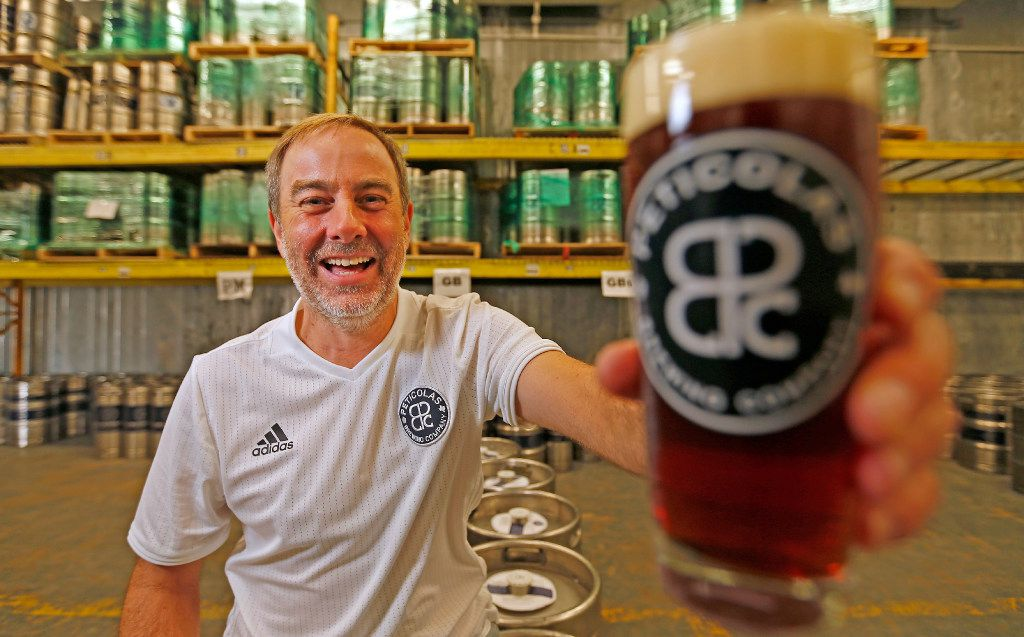 Owner Michael Peticolas poses for a photograph with beer at Peticolas Brewing Company in Dallas, Friday, Oct. 14, 2016.
