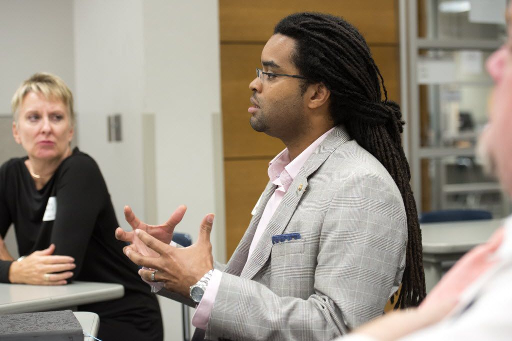 Darius Frasure, a professor at Mountain View College, participates in a small group session during the July 29 race relations event. (Jeffrey McWhorter/Special Contributor)