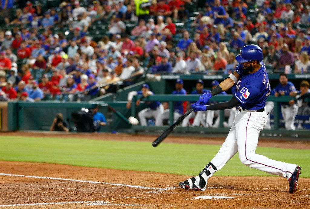 Texas Rangers right fielder Nomar Mazara (30) hits a home run in the fourth inning against the Boston Red Sox during their game at Globe Life Park in Arlington, Texas on May 3, 2018. (Nathan Hunsinger/The Dallas Morning News)
