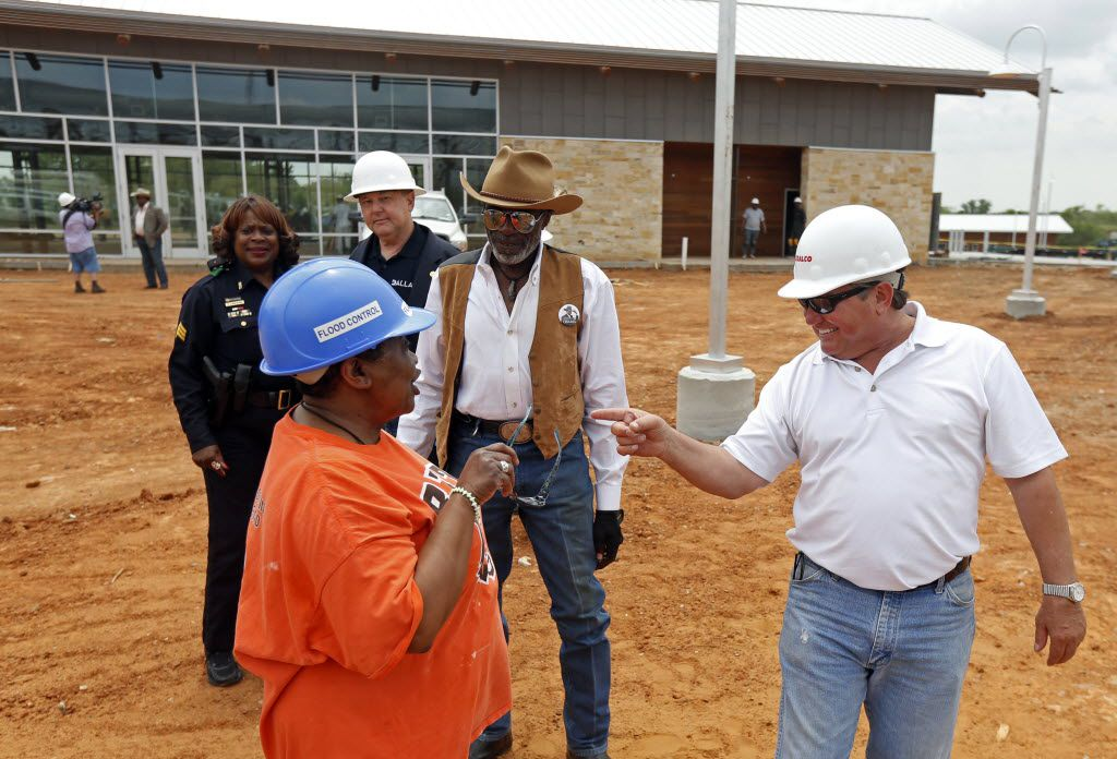 Vonciel Jones Hill, then a Dallas City Council member, talks to Wayne Kirk, far right, during a tour of the Texas Horse Park on May 7, 2014.