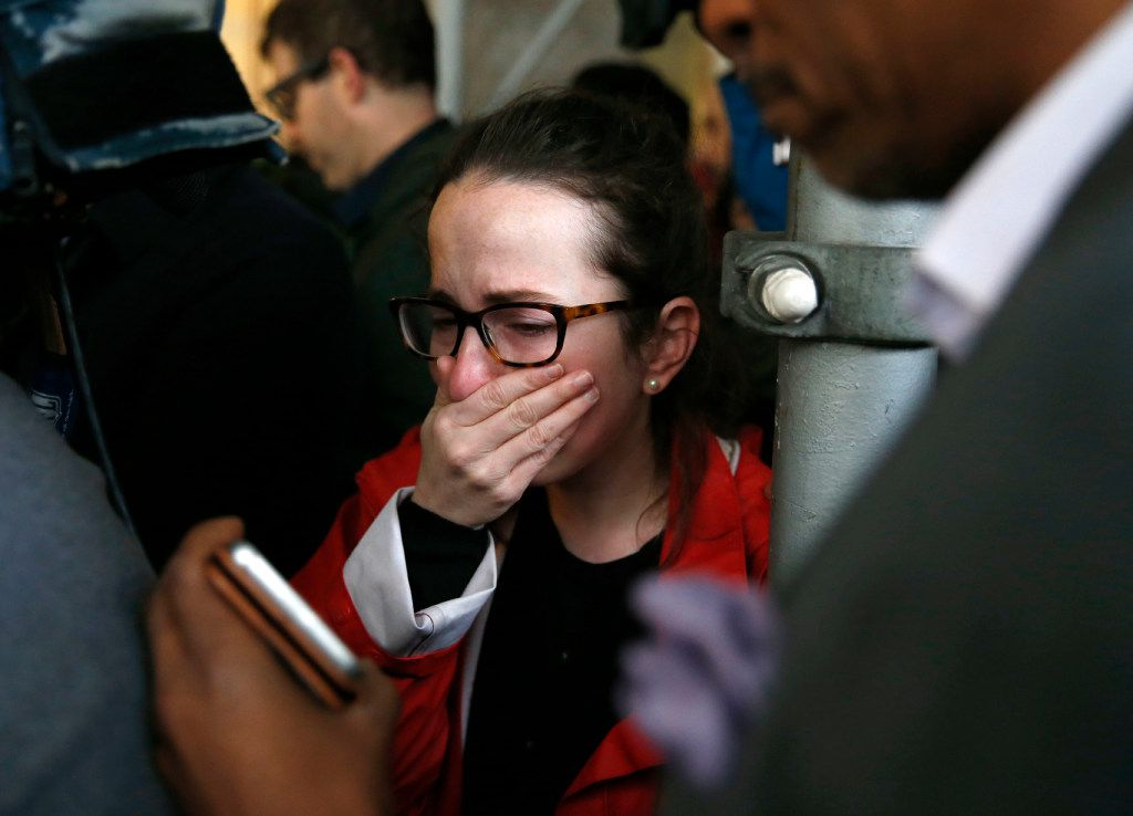 A Clinton supporter breaks down while watching a live feed of Hillary Clinton's concession speech. (Vernon Bryant/Staff Photographer)