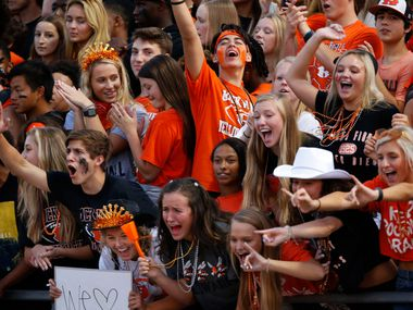 "Members of the ""Swarm"" (Rockwall's student section) cheer on the team during the first half of a high school football game against  Highland Park at Wilkerson-Sanders Stadium in Rockwall on Friday, August 30, 2019. (John F. Rhodes / Special Contributor)"