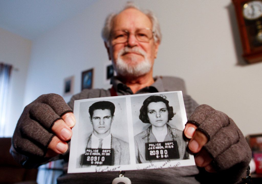 David Myers holds a copy of the booking photos of himself and his then-girlfriend, Winonah Beamer, in his room at Mustang Creek Estates of Frisco on Feb. 7, 2019. Winonah soon after became his wife. They both were part of the Freedom Rides movement and traveled to Jackson, Miss., in 1961 to sit in segregated waiting rooms at transportation stations as part of the civil rights movement.