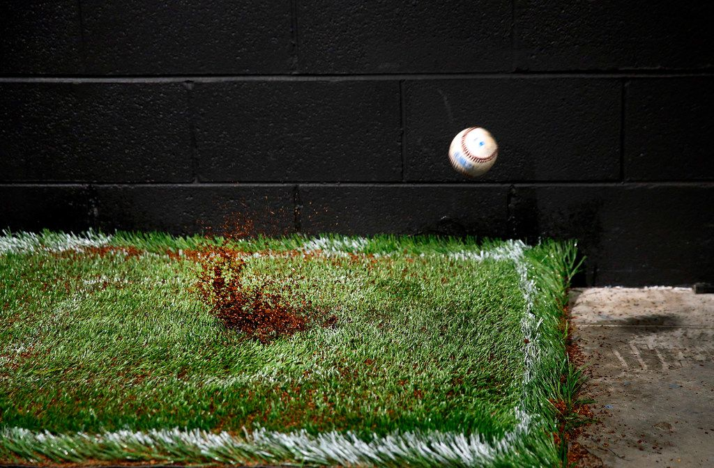 A baseball is fired at 85-100 mph at a turf sample in the Shaw Sports Turf's indoor performance lab in Dalton, Georgia, Monday, November 19, 2018.  The Texas Rangers are considering using Shaw's B1K playing surface for Globe Life Field which is under construction in Arlington. (Tom Fox/The Dallas Morning News)