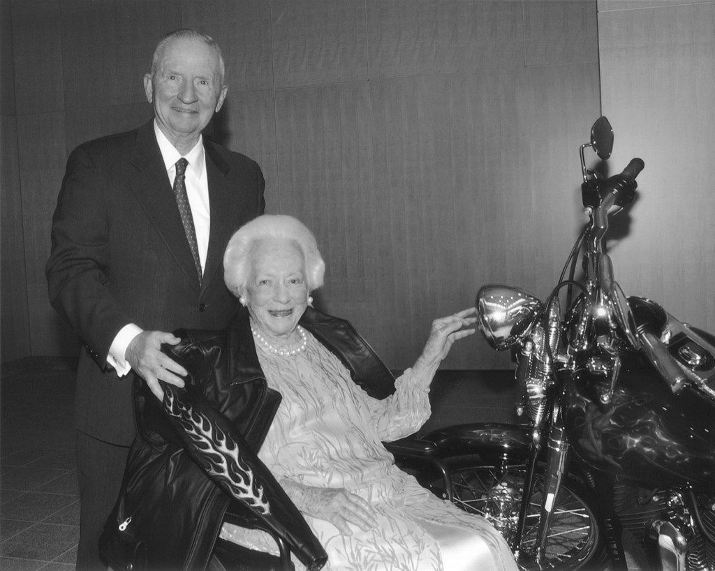 Ross Perot with Margaret McDermott at a party thrown in her honor at University of Texas Southwestern Medical Center in 2006. Perot borrowed a Harley from Strokers Dallas and gave McDermott a motorcycle jacket at the party as a gag.